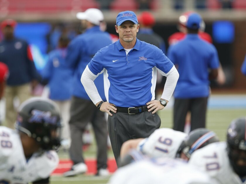 Tulsa head coach Philip Montgomery watches during team warm ups before an NCAA college football game against SMU, Saturday, Oct. 31, 2015, in Dallas. (AP Photo/Jim Cowsert)