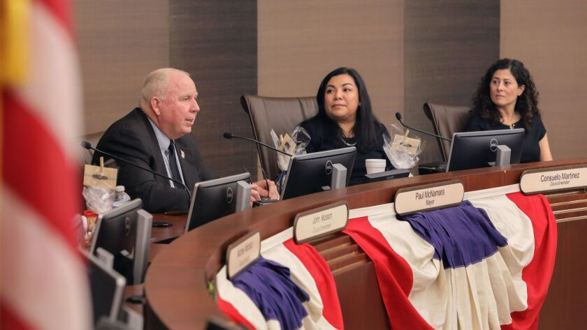 New Escondido Mayor Paul McNamara, left, speaks at tonight's City Council meeting after he and new Councilmember Consuelo Martinez, middle, were sworn into office. At far right is Councilmember Olga