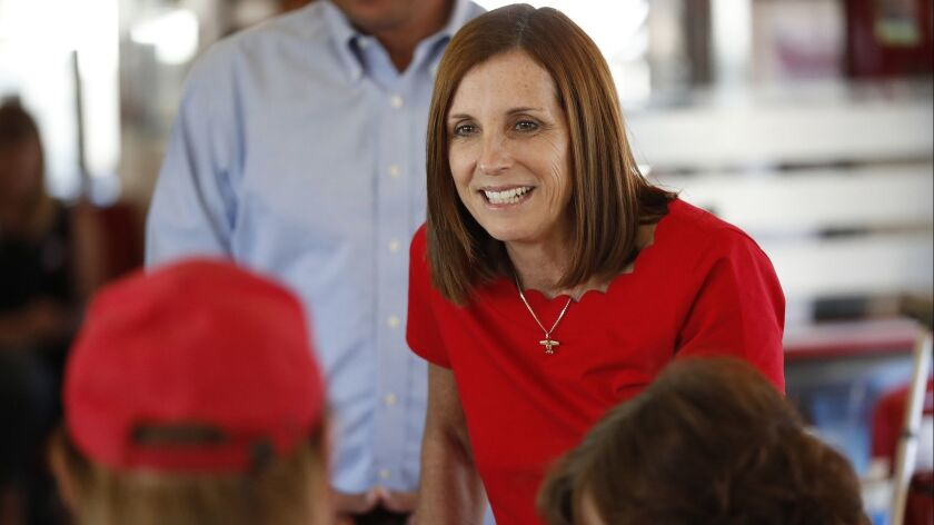 Martha McSally speaks with voters at Chase's diner in Chandler, Ariz., on Nov. 6.