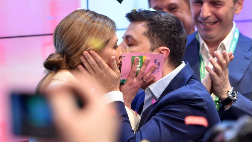 Ukrainian president-elect Volodymyr Zelensky kisses his wife Olena after the announcement of the first exit poll results in Ukraine's presidential election at his campaign headquarters in Kiev on April 21.