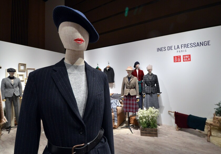 Japanese fashion giant Uniqlo's fall and winter 2015 collection, inspired by French fashion icon Ines de la Fressange, on display in Tokyo. Uniqlo is to open at Los Cerritos Center this week.