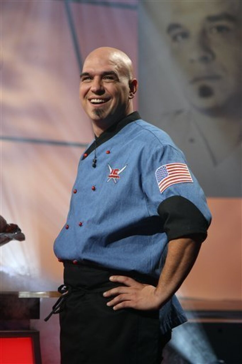 FILE - In this undated image released by the Food Network, chef Michael Symon, is shown. Cleveland native Michael Symon, one of Food Network's Iron Chefs, has offered to go to LeBron James' house once a month and cook a meal for the MVP's family and friends if he re-signs as a free agent with the Cavaliers. Symon posted a letter to James on his Facebook page. (AP Photo/Food Network, File)