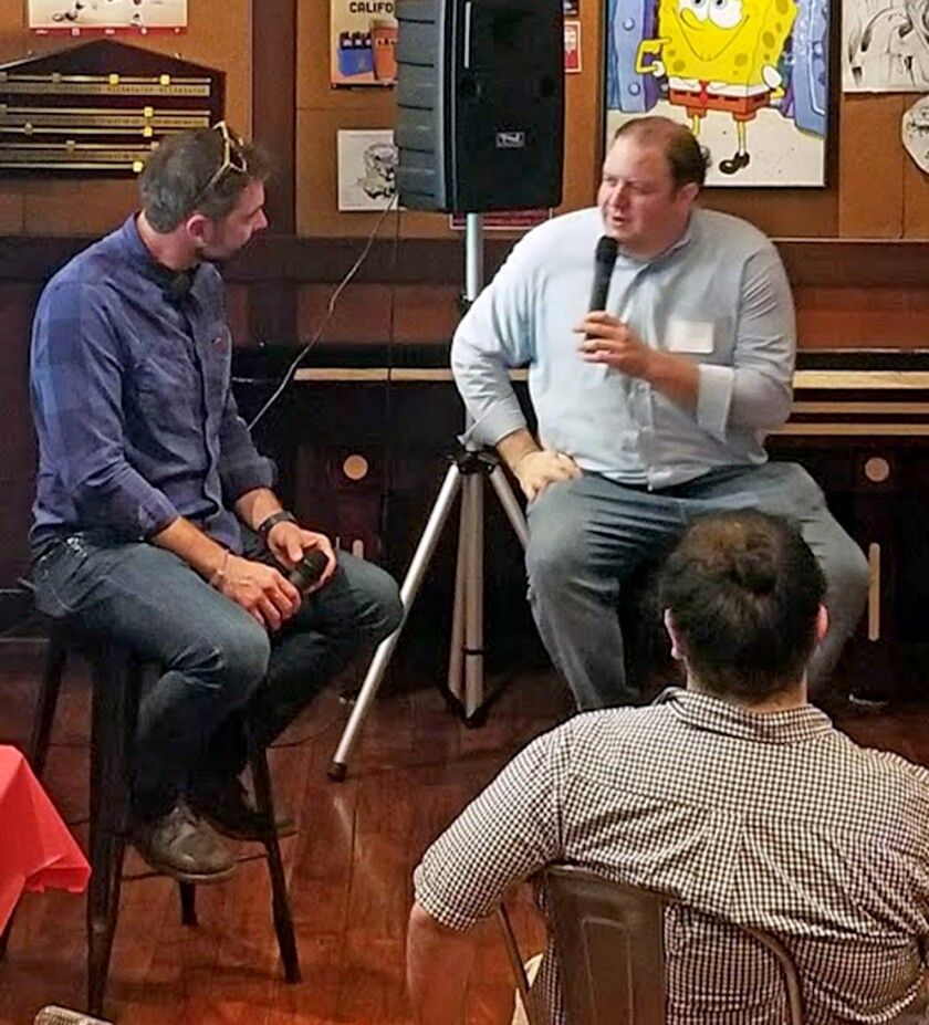 Brent Bushnell, left, chief executive of Two Bit Circus, chats with tech talk facilitator David Murphy, chief executive of Tech Fire, on Wednesday in Burbank.