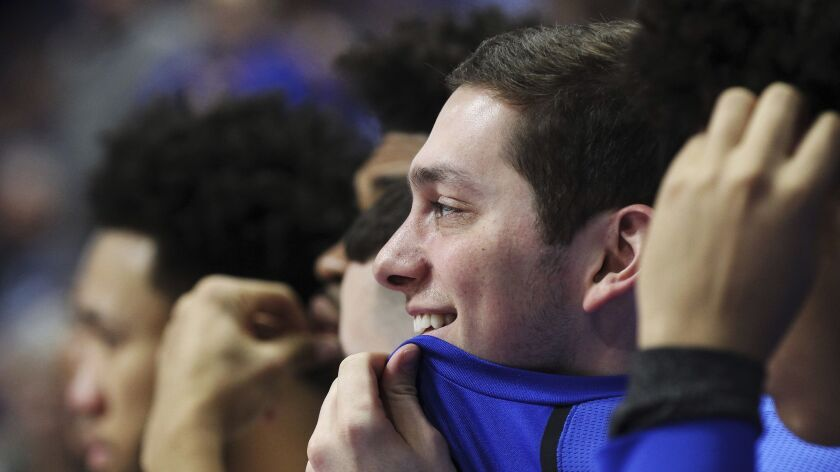 Kentucky senior Jonny David smiles as the crowd chants his name late in the second half of an NCAA c