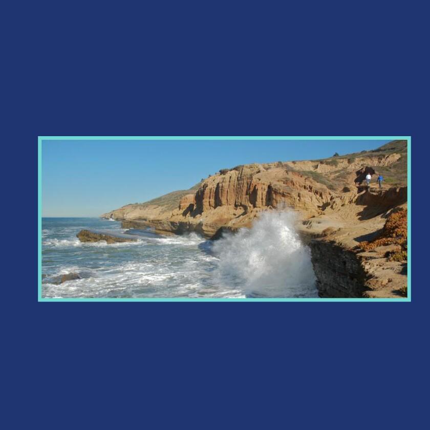 An image of ocean waves crashing into cliffs.