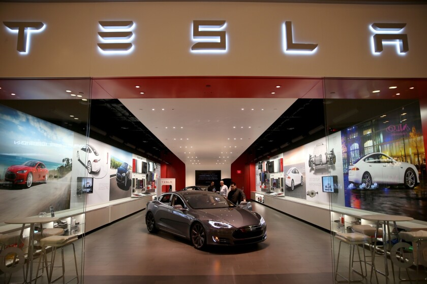 California officials say they are making an all-out effort to get Tesla Motors to build an electric-car factory in California. Above, a Tesla showroom at the Dadeland Mall in Miami.