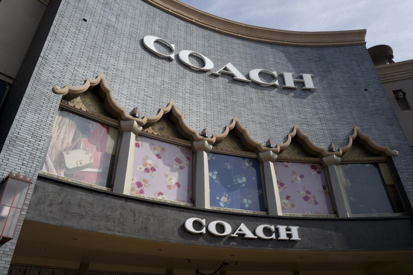 FILE - This May 3, 2019 file photo shows a Coach retail shop at the Citadel Outlets in Commerce, Calif. Strong sales results from Coach's parent as well as from the maker of Wrangler and Lee jeans offer the latest evidence that shoppers' spending on clothing and accessories is rebounding to pre-pandemic levels. Tapestry Inc. on Thursday, May 6, 2021, reported fiscal third-quarter results that beat Wall Street estimates as spending on luxury goods rebounded from a malaise last year. (AP Photo/Richard Vogel, File)