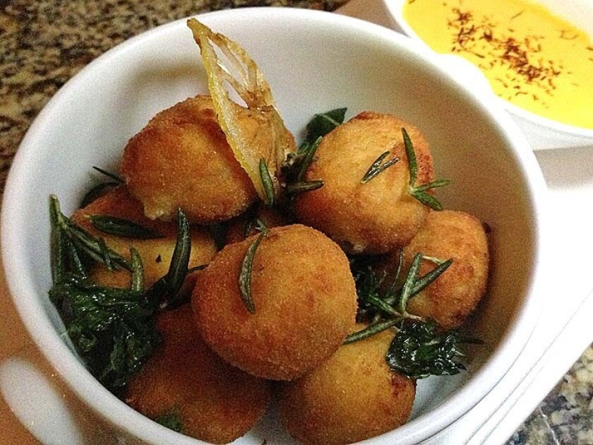 Lobster fritters are served with a saffron aioli.