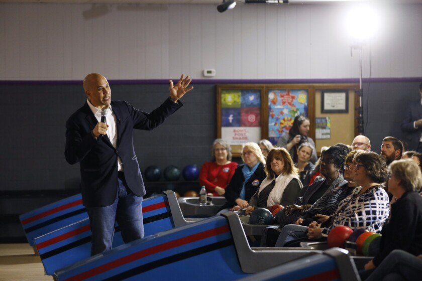 Sen. Cory Booker (D-N.J.), speaks at the Adel Family Fun Center in Adel, Iowa, on Dec. 20, a few weeks before suspending his campaign for the presidency.