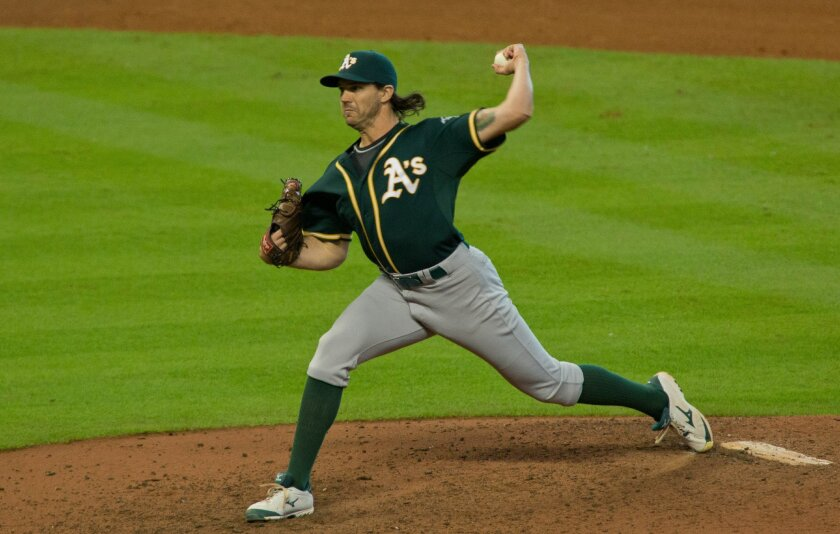 Oakland Athletics pitcher Barry Zito pitches in relief of starter Aaron Brooks to the Houston Astros in the eighth inning of a baseball game Sunday, Sept. 20, 2015, in Houston. (AP Photo/Richard Carson)