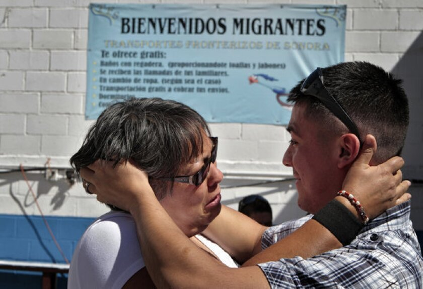 Jorge Arroyo, 19, tearfully greets his mother at a migrant shelter in Nogales, Mexico. She came to take him back home to live in Mexico City. The teenager said he was deported after a dozen years as an illegal immigrant.