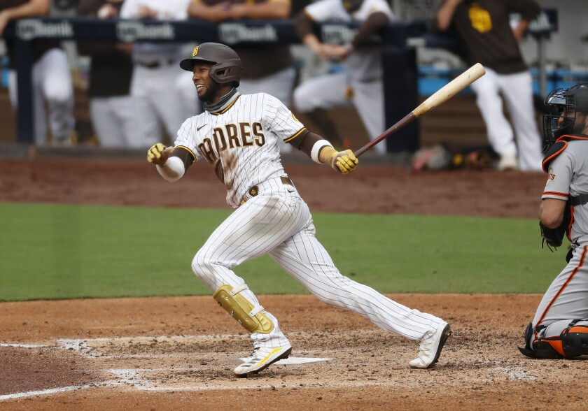Jurickson Profar of the San Diego Padres hits a RBI single