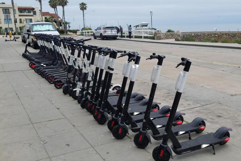 I call this image 'Scooter Invasion.' — William Pieren ... Dockless, electric scooters are dropped off on public spaces and blocking sidewalks everyday, throughout La Jolla — and have become the topic of debate and frustration to many residents.