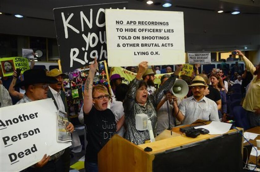 Protesters take over the Albuquerque City Council meeting Monday. City officials warned that rules would be strictly enforced at Thursday night's meeting.