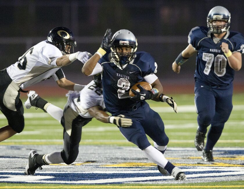 Madison running back Pierre Cormier breaks off a long run in the Warhawks' win over Olympian. Cormier finished with touchdown runs of 4, 1 and 20 yards as Madison improved its record to 4-0.
