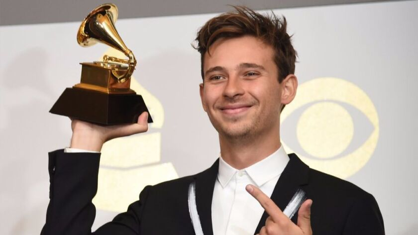 Flume poses in the press room with his Grammy for Best Dance/Electronic Album for 'Skin' during the 59th Grammy Awards at Staples Center on February 12, 2017 in Los Angeles