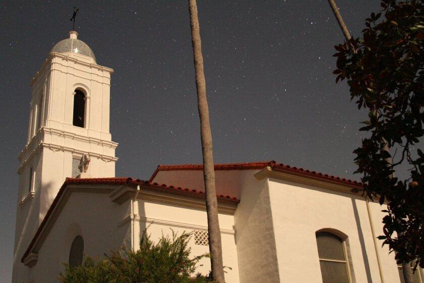 Palm trees wave in the slight breeze in darkened La Jolla. Photos by Jeremy W. Smith