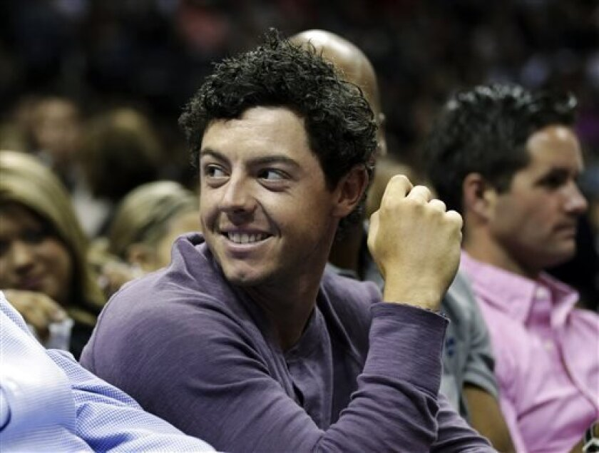 Golfer Rory McIlroy attends an NBA basketball game between the San Antonio Spurs and Miami Heat, Sunday, March 31, 2013, in San Antonio. McIlroy is scheduled to play in the Texas Open golf tournament in San Antonio this week. (AP Photo/Eric Gay)