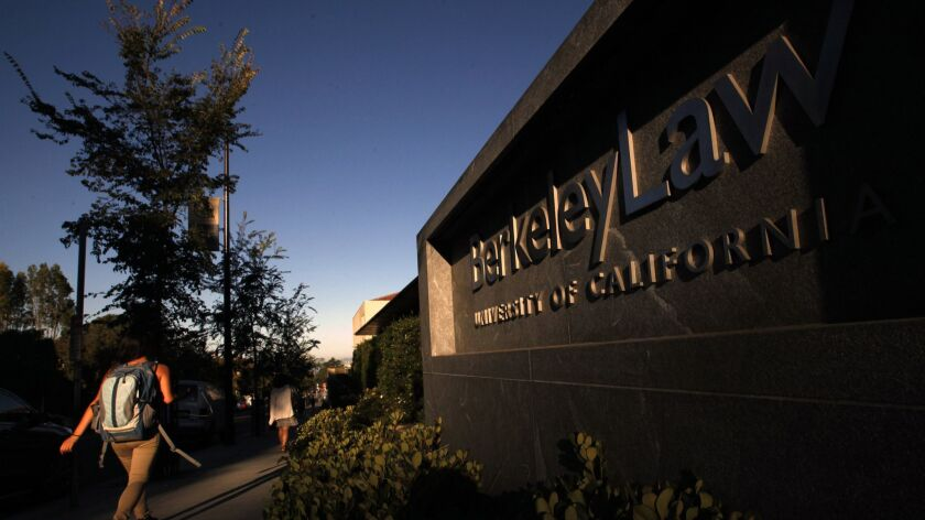 BERKELEY, CA - SEPTEMBER 09, 2015: Students pass the Berkeley School of Law in the early morning lig