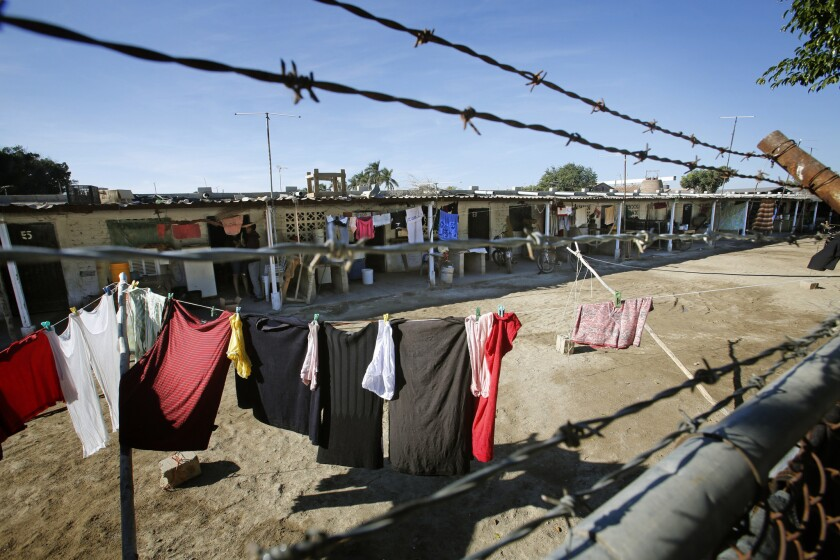 DECEMBER 10, 2013. GUASAVE, SINALOA, MEXICO. At Campo Sacramento in Guasave, Sinaloa, barbed wire runs along the perimeter, and arrivals and departures are controlled around the clock. (Don Bartletti / Los Angeles Times)