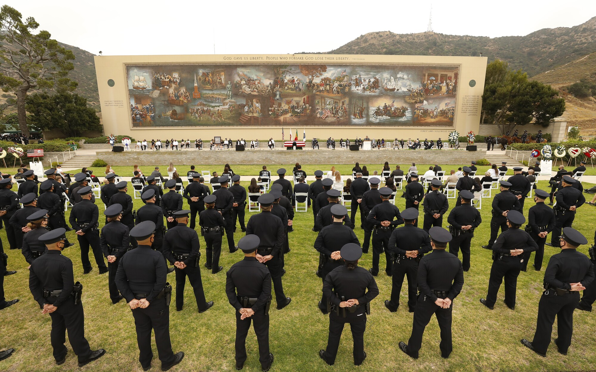 LAPD officers attend the funeral for Officer Valentin Martinez at Forest Lawn Hollywood Hills.
