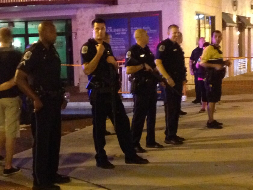 Police stand near the site of a shooting at ZombiCon that police say killed at least one person and injured four others in Fort Myers, Fla.