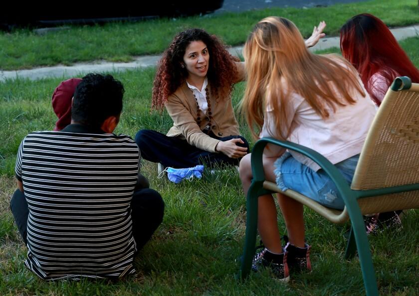 Attorney Claudia Cubas talks to Jose and his children in April