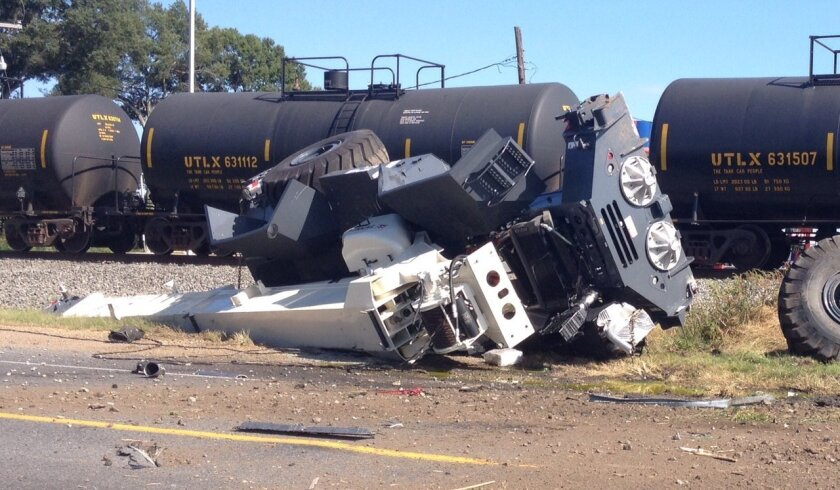 This photo shows a train derailment, Sunday, Oct. 5, 2014, in Mer Rouge, La. Two train engineers were in serious condition Sunday after their freight train hit a transport truck in northeast Louisiana, derailing two engines and 16 tank and hopper cars. (AP Photo/The News-Star, Barbara Leader) NO SALES