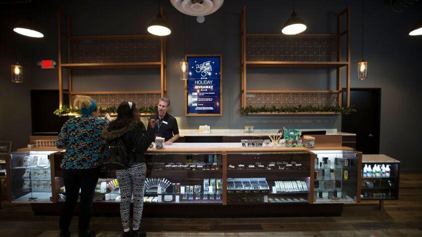 Patrons shop at Bud and Bloom, a Santa Ana marijuana dispensary.