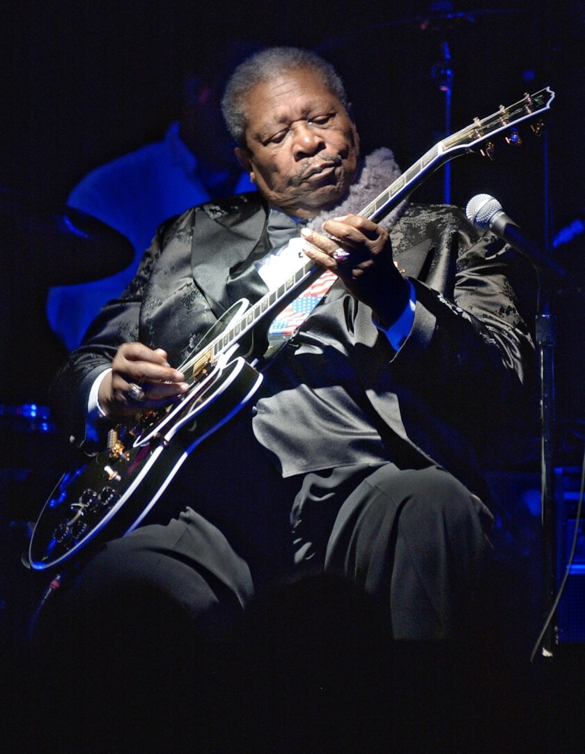 "FILE - This June 20, 2002 file photo shows blues legend B.B. King performing at the second anniversary celebration of B.B. King's Blues Club and Grill in New York. A guitar given to B.B. King for his 80th birthday has sold for $280,000 at an auction of items from the blues legend's estate. Julien's Auctions says King often used the black Gibson ES-345 prototype that was one of several guitars he called ""Lucille. (AP Photo/Richard Drew, File)"