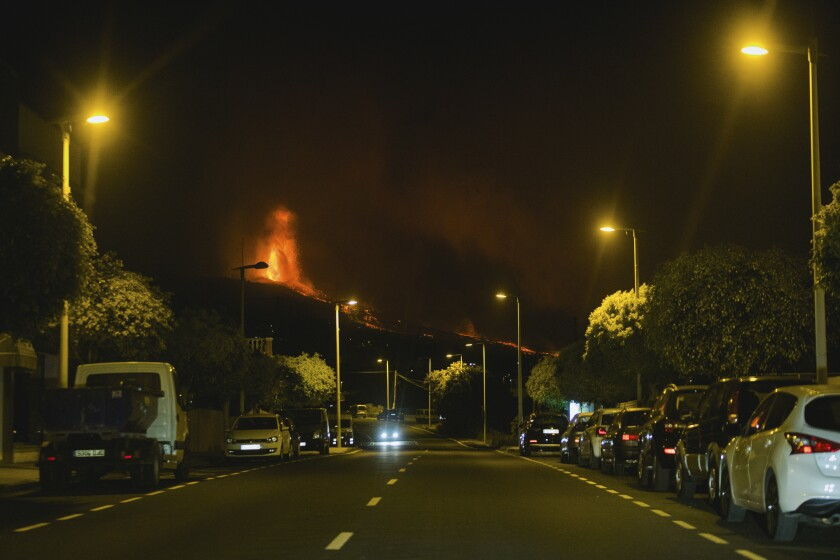 Lava flows from an eruption of a volcano near El Paso on the island of La Palma in the Canaries, Spain, in the early hours of Monday, Sept. 20, 2021. Lava continues to flow slowly from a volcano that erupted in Spain's Canary Islands off northwest Africa. The head of the islands' regional government says Monday he expects no injuries to people in the area after some 5,000 were evacuated. (AP Photo/ Jonathan Rodriguez)