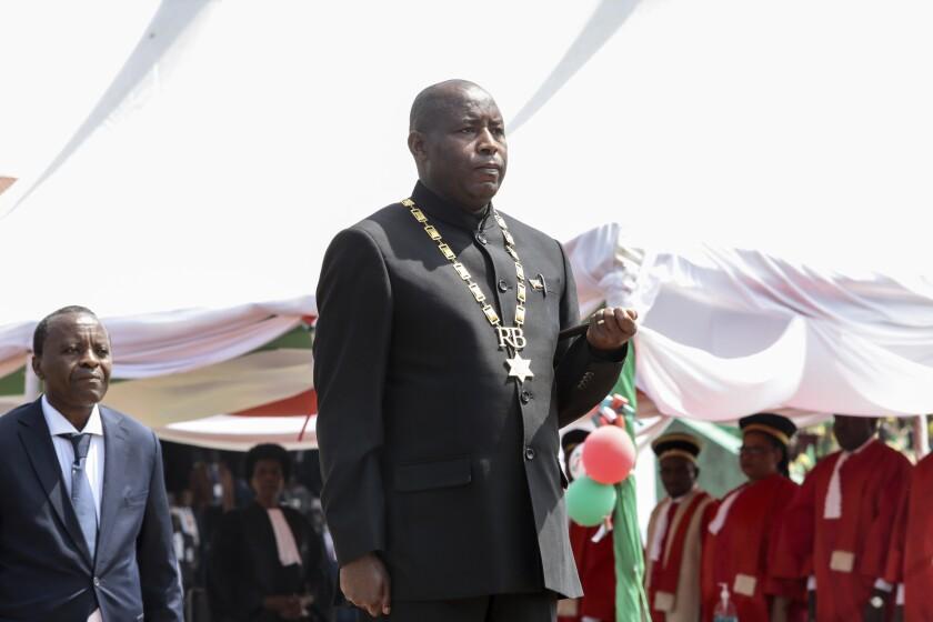 Burundi's President Evariste Ndayishimiye is inaugurated in Gitega, Burundi Thursday, June 18, 2020. President Evariste Ndayishimiye took power two months early after the abrupt death of his predecessor Pierre Nkurunziza. (AP Photo/Berthier Mugiraneza)