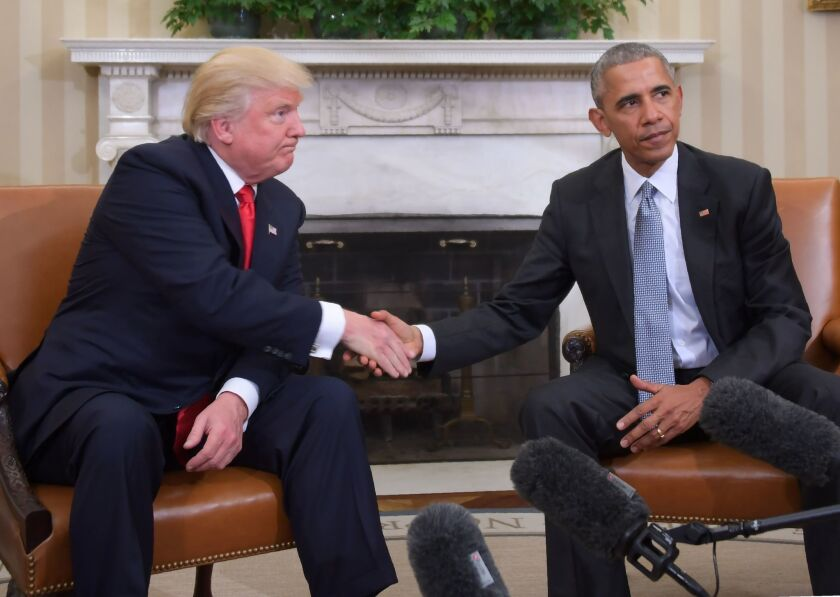 Then-President Obama shakes hands with Donald Trump, then president-elect, at the White House on Nov. 10, 2016.