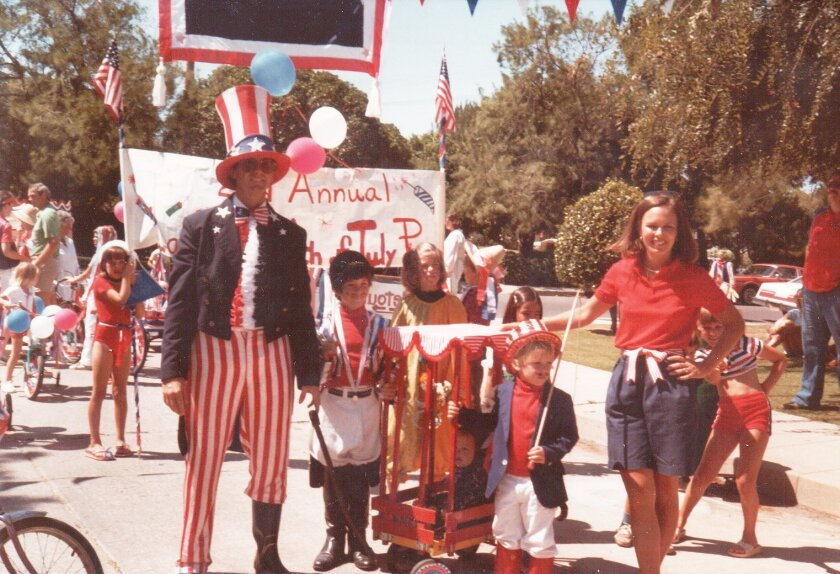 A young Russ Murfey (in wagon) and older brother, Scott Murfey (in front with stick), as seen during the 1982 Bird Rock Fourth of July Parade. Also pictured are their parents, Barbara and Buddy, who helped found the community tradition in 1980. This year, Russ and Scott, along with their company, M