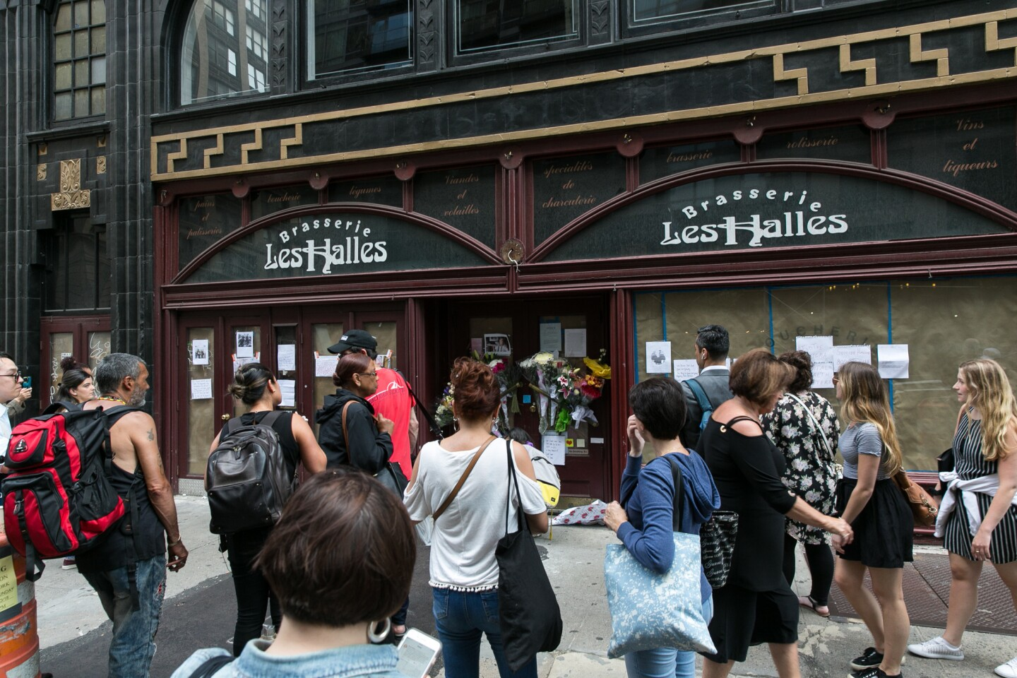 Fans gather to grieve and remember Anthony Bourdain on Friday afternoon, June 8, 2018, at French restaurant Brasserie Les Halles on Park Ave. South, where he once worked as executive chef. The iconic television host died early this morning in France.