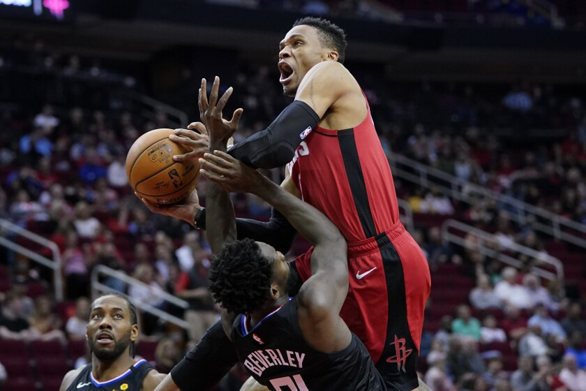 Rockets guard Russell Westbrook is fouled by Clippers guard Patrick Beverley during the second half of a game March 5 in Houston at the Toyota Center.