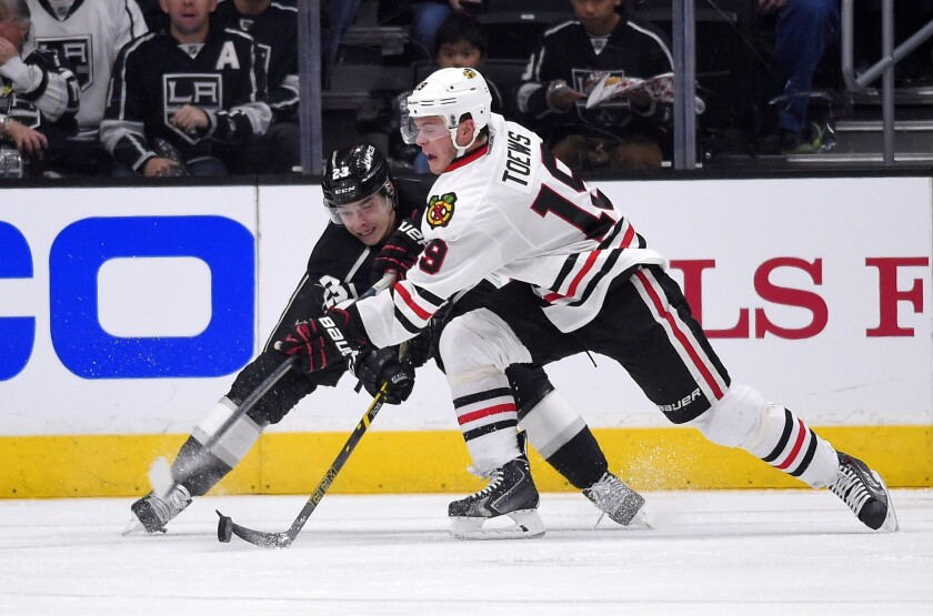 Dustin Brown and Blackhawks center Jonathan Toews mix it up during the second period of the Kings' 4-3 win Wednesday over Chicago at Staples Center.