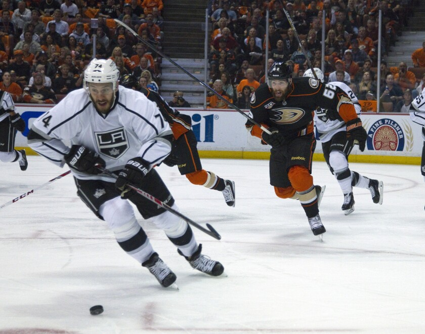 Kings left wing Dwight King (74) charges after a loose puck with Ducks left wing Patrick Maroon (62) giving chase in Game 5 of the Western Conference semifinal series on Monday.