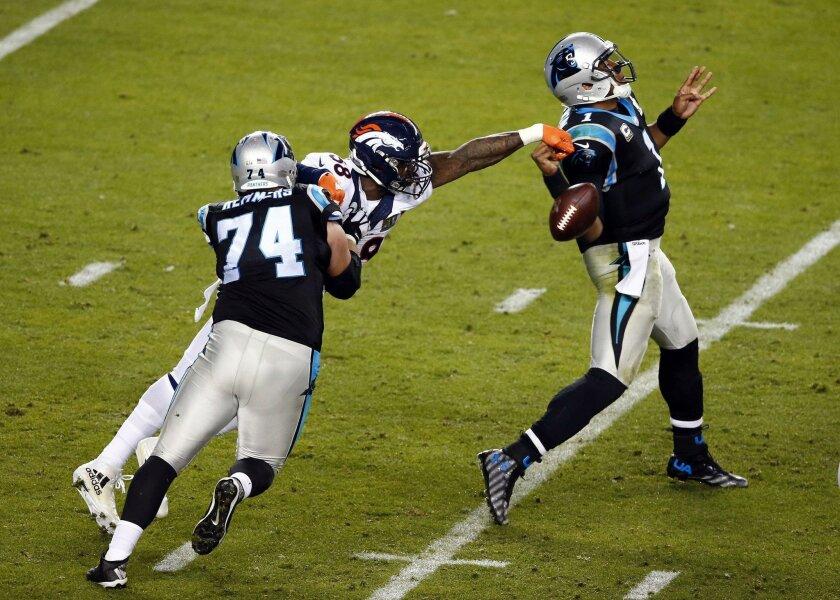 Denver Broncos linebacker Von Miller forces a fumble by Carolina Panthers quarterback Cam Newton in the fourth quarter of Super Bowl 50.