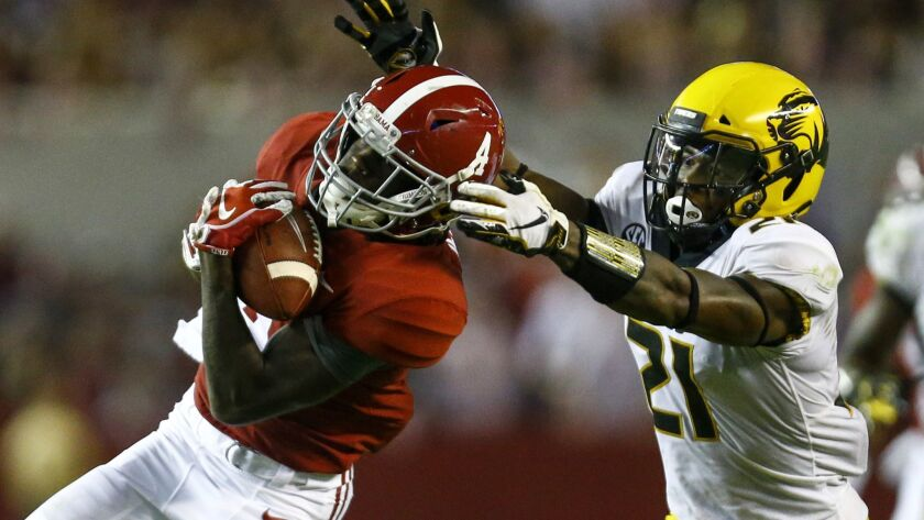 FILE - In this Oct. 13, 2018, file photo, Alabama wide receiver Jerry Jeudy (4) catches a pass over