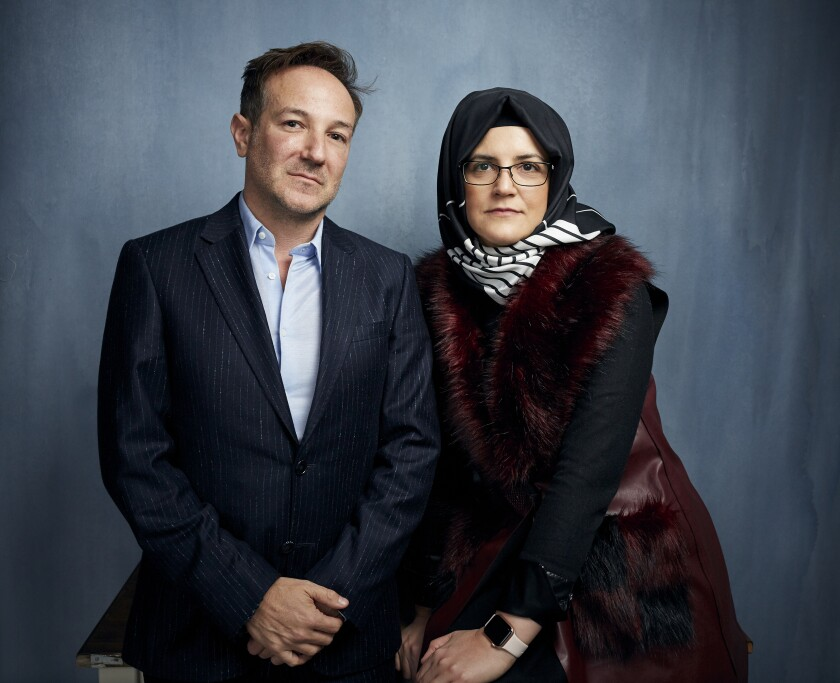 "FILE - Director Bryan Fogel, left, and Hatice Cengiz, fiancee of the murdered journalist Jamal Khashoggi, pose for a portrait to promote the film ""The Dissident"" during the Sundance Film Festival in Park City, Utah on Jan. 24, 2020. Briarcliff Entertainment said Wednesday that it has acquired ""The Dissident"" and will release it theatrically and via on-demand in late 2020 to coincide with the second anniversary of Khashoggi's death. (Photo by Taylor Jewell/Invision/AP, File)"