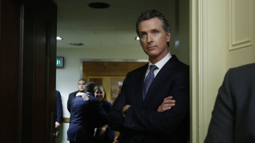 The governor-elect, Lt. Gov. Gavin Newsom, watches the Assembly session at the Capitol on Dec. 3 in Sacramento.