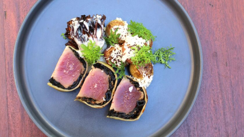 Tuna Wellington, one of executive chef Anthony Wells' signature dishes at Juniper & Ivy restaurant i