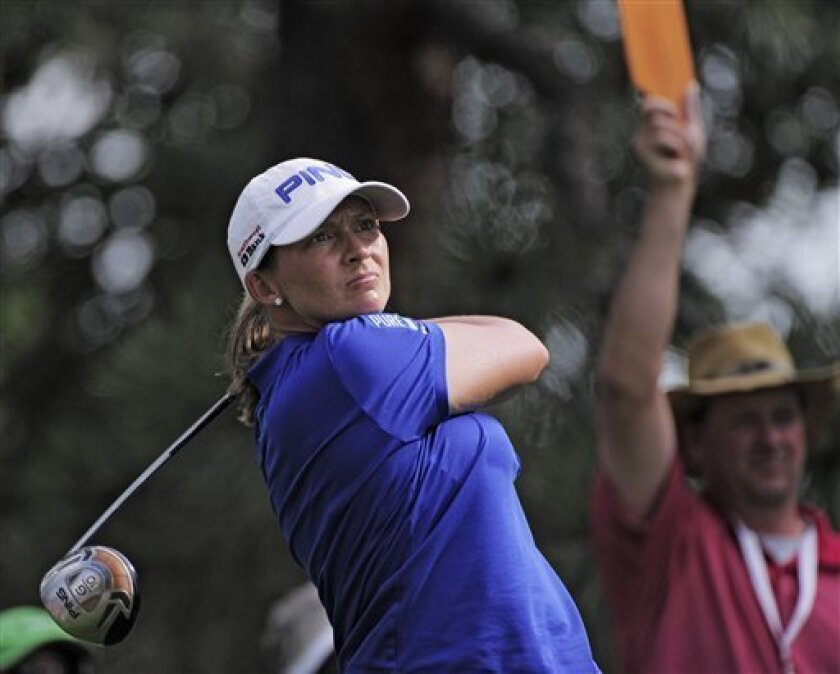 Angela Stanford tees off on the seventh hole during the delayed third round of the Women's U.S. Open golf tournament at the Broadmoor Golf Club on Sunday, July 10, 2011, in Colorado Springs, Colo. (AP Photo/Mark J. Terrill)