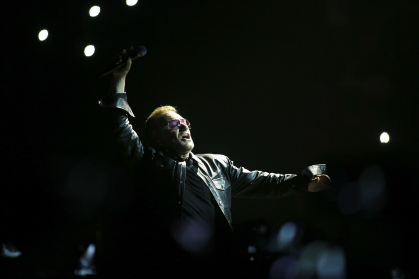 U2's Bono greets the audience at the Forum in 2014.