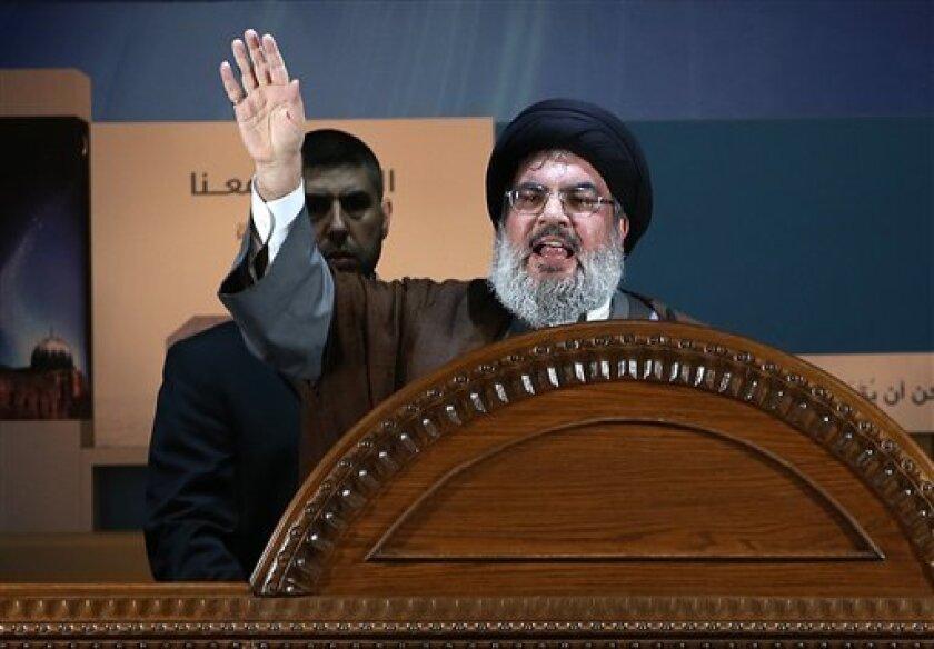 Hezbollah leader Sheik Hassan Nasrallah speaks during a rally to mark Jerusalem day or Al-Quds day, in a southern suburb of Beirut, Lebanon, Friday, Aug. 2, 2013. The leader of Hezbollah made a rare public appearance Friday, pledging in a speech before thousands of supporters near the Lebanese capital that his militant group will continue fighting Israel and will never abandon Palestinians. The last Friday of the Islamic holy month of Ramadan is observed in many Muslim countries as Al-Quds day,