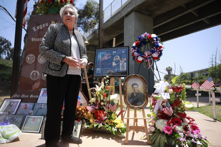 Esther Jauregui next to tributes to her uncle, Rudy Martinez
