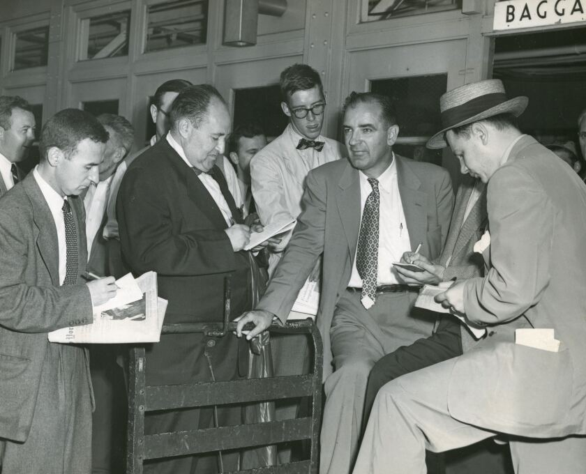 Sen. Joseph McCarthy speaks with reporters at LaGuardia Airport shortly after his victory over Len Schmitt in the 1952 Wisconsin Republican primary.