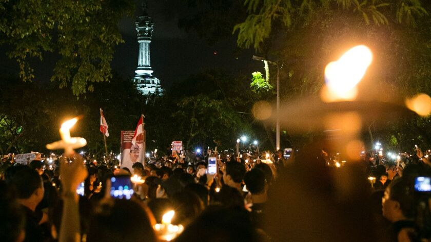 Supporters march in support of Jakarta's former governor Basuki Tjahaja Purnama, of May 11, after an Indonesian court sentenced him to two years in jail for blasphemy.
