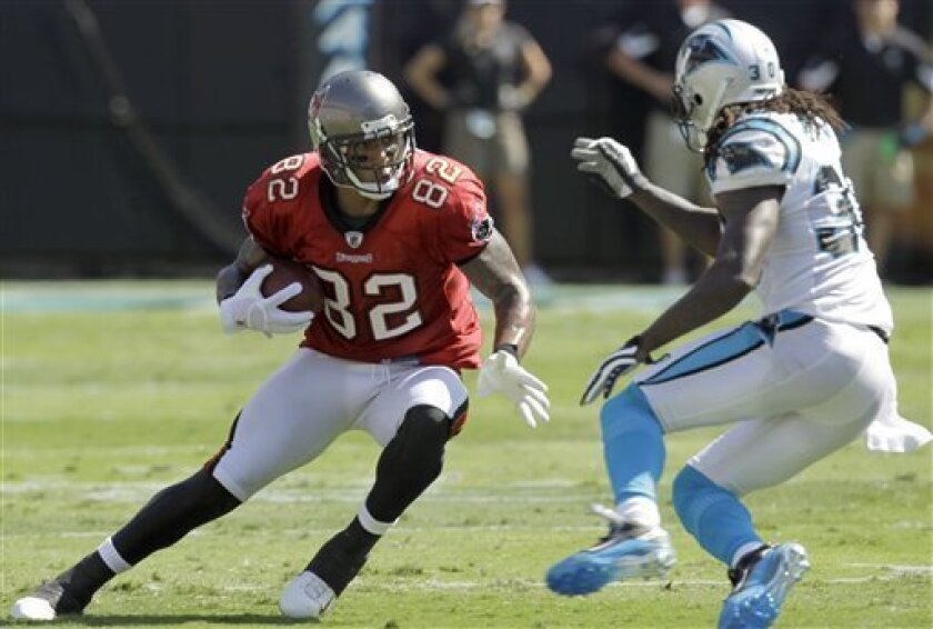 Tampa Bay Buccaneers' Kellen Winslow (82) runs after a catch as Carolina Panthers' Charles Godfrey, right, defends in the second half of the Buccaneers' 20-7 win in an NFL football game in Charlotte, N.C., Sunday, Sept. 19, 2010. (AP Photo/Chuck Burton)